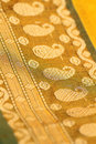 Golden embroidery on Indian saree. Stock Image