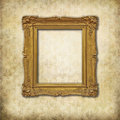 Golden empty frame on a grunge wall Royalty Free Stock Photography