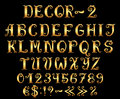 Golden english alphabet with numbers and symbols decorative vintage Royalty Free Stock Photo