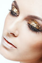 Golden eye makeup close up shot of female face with vogue shining Royalty Free Stock Photos