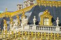 Golden fence with ornaments and roof of versailles palace near the castle in france patterns colors needles on the wall statues on Royalty Free Stock Photography