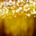 Golden festive fantasy background bokeh with stars Royalty Free Stock Photo