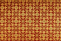Golden flora painted on Thai temple ceiling Stock Photos