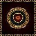 Golden floral frame with heraldic elements Stock Photos