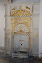 The Golden Fountain. The golden fountain Mag-tooth is made of marble and is located in a fountain courtyard near the entrance to