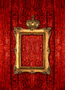 Golden frame with crown over red wooden background rustic Stock Images