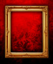 Golden frame on floral wall Royalty Free Stock Image