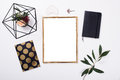 Golden frame mock-up on white tabletop Royalty Free Stock Photo