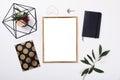 Golden frame mock-up on white tabletop Royalty Free Stock Photo