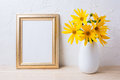 Golden frame mockup with yellow rosinweed flowers in vase Royalty Free Stock Photo