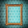 Golden frame over grunge wallpaper Royalty Free Stock Photo