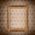 Golden frame over wallpaper Royalty Free Stock Photo