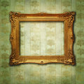 Golden frame on vintage green wallpaper Royalty Free Stock Image
