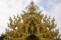 Golden gable apex in wat rong khun thailand white temple chiangrai Royalty Free Stock Photography