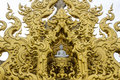 Golden gable apex in wat rong khun thailand white temple chiangrai Stock Image