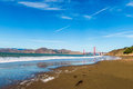 Golden Gate Bridge and Beach Footprints Royalty Free Stock Photo