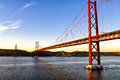 Golden gate bridge and Christ the King statue in Lisbon Royalty Free Stock Photo