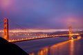 The Golden Gate Bridge glows just before sunrise Stock Photography