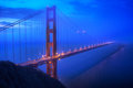 Golden gate bridge in san fransisco at blue hour surrounded with fog Royalty Free Stock Image