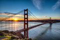 Golden gate bridge at sunrise blue sky over the in san francisco california Stock Photos