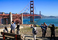 Golden gate bridge visitors taking photos take of beautiful morning view of the world famous one of the iconic features of the san Royalty Free Stock Image