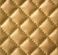 Golden genuine leather texture beautiful upholstery Royalty Free Stock Image
