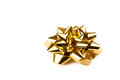 Golden gift bow Royalty Free Stock Image