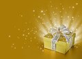 Golden gift box background with stars ribbon bow and Royalty Free Stock Photography