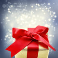Golden gift box with big red ribbon Royalty Free Stock Photo