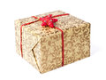 Golden gift box with red ribbon and star clipping path included Stock Image