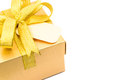 Golden gift box white background Stock Photo