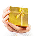 Golden gift in hands Royalty Free Stock Image