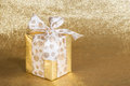Golden gift wrapped present Royalty Free Stock Photo