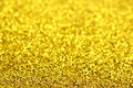 Golden glitter with blurs for background use Royalty Free Stock Images