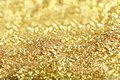 Golden glitter close up of Stock Photography