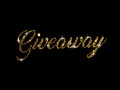 Golden glitter of hand writing word GIVEAWAY