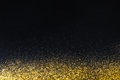Golden glitter sand texture border on black, abstract background. Royalty Free Stock Photo