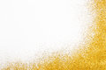 Golden glitter sand texture frame on white, abstract background. Royalty Free Stock Photo