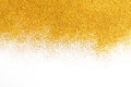 Golden glitter sand texture on white, abstract background. Royalty Free Stock Photo