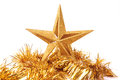 Golden glittering star shaped Christmas ornament i Royalty Free Stock Photo