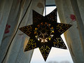 Golden glittering star shaped Christmas paper ornament Royalty Free Stock Photo