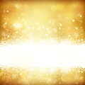 Golden glowing christmas background with stars snowflakes and lights festive gold out of focus light dots copy space great for the Royalty Free Stock Photography