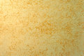 Golden grunge rough surface of stucco concrete wall. Royalty Free Stock Photo