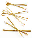 Golden hairpins over white background Stock Photo