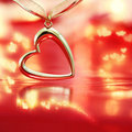 Golden heart on blazing red background Royalty Free Stock Photo