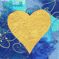 Golden heart on blue background Stock Photo