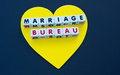 Golden heart marriage bureau a large gold yellow shape on a black background with text inscribed in uppercase letters on small Royalty Free Stock Photo