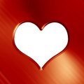 Golden heart on a soft red background Royalty Free Stock Image