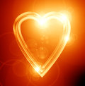 Golden heart on a soft red background Stock Images
