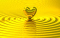 Golden heart touch making ripples Royalty Free Stock Photo